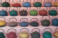 Teapots in a store window on a street in Saint-Germain-des-Prés, Paris, France.