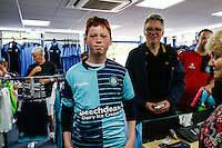 A young Wycombe Wanderers fan loos happy with his new replica shirt during the 2016/17 Kit Launch of Wycombe Wanderers to the public at Adams Park, High Wycombe, England on 10 July 2016. Photo by David Horn.