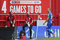Joe Garner of Wigan heads to the dressing room after being shown a red card during Brentford vs Wigan Athletic, Sky Bet EFL Championship Football at Griffin Park on 4th July 2020