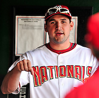 30 September 2009: Washington Nationals third baseman Ryan Zimmerman chats it up in the dugout prior to a game against the New York Mets at Nationals Park in Washington, DC. The Nationals rallied in the bottom of the 9th inning on a Justin Maxwell walk-off Grand Slam to win 7-4 and sweep the Mets 3-game series capping the Nationals' 2009 home season. Mandatory Credit: Ed Wolfstein Photo