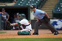 Home plate umpire Danny Collins stands behind Joe Gomez (40) of the Miami Hurricanes in the game against the Georgia Tech Yellow Jackets during game one of the 2017 ACC Baseball Championship at Louisville Slugger Field on May 23, 2017 in Louisville, Kentucky. The Hurricanes walked-off the Yellow Jackets 6-5 in 13 innings. (Brian Westerholt/Four Seam Images)