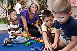 September 14, 2011. Raleigh, NC. . Kim Jackson, the head teacher for the class engages in activities with several of her students.. Project Enlightenment, a public pre-kindergarten program for at risk children, has been threatened with closure due to state wide budget cuts..