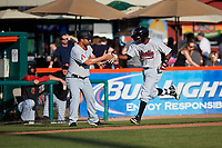 Visalia Rawhide designated hitter Luis Alejandro Basabe (5) is congratulated by third base coach Travis Denker (13) after hitting his first home run of the season during a California League game against the San Jose Giants on April 13, 2019 at San Jose Municipal Stadium in San Jose, California. Visalia defeated San Jose 4-2. (Zachary Lucy/Four Seam Images)