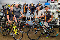 Joshua Johnson, age 13, left, Phillip Johnson, Martha Tamatea and Harlem Tamatea, age 12, Kiwivelo bike presentation at Kiwivelo Cycling, Takapuna, New Zealand on Saturday, 7 November 2015. Photo: David Rowland / lintottphoto.co.nz