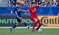 """CARSON, CA - FEBRUARY 15: Javier """"Chicharito"""" Hernandez #14 of the Los Angeles Galaxy gets after Omar Gonzalez #44 of Toronto FC with the ball during a game between Toronto FC and Los Angeles Galaxy at Dignity Health Sports Park on February 15, 2020 in Carson, California."""