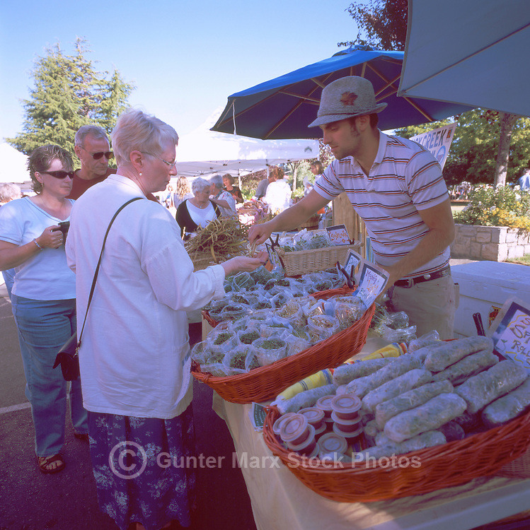 Farmer selling Bean Sprouts at the Saturday Market in Ganges, on Saltspring Island, in the Southern Gulf Islands of British Columbia, Canada