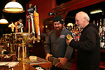 WATERTOWN, CT-23 December 2013-122313LW01 - Dwight Smith, right, the new owner of the Red Door music venue in Watertown, and his son, Dean Smith, install a dispenser that will fill beer glasses from the bottom up. The Red Door reopened Thursday after nearly three months of renovations.<br /> Laraine Weschler Republican-American