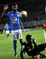 BOGOTA - COLOMBIA -31 - 03 - 2016: Hector Quiñonez (Izq.) jugador de Millonarios disputa el balón con Francisco Najera (Der.) jugador de Atletico Nacional, durante partido aplazado de la fecha 9 entre Millonarios y Atletico Nacional, de la Liga Aguila I-2016, jugado en el estadio Nemesio Camacho El Campin de la ciudad de Bogota.   / Hector Quiñonez (L) player of Millonarios vies for the ball with Francisco Najera (R) player of Atletico Nacional, during a postponed match between Millonarios and Atletico Nacional, for the date 9 of the Liga Aguila I-2016 at the Nemesio Camacho El Campin Stadium in Bogota city, Photo: VizzorImage / Luis Ramirez / Staff.