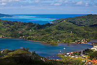 View of Haamene Bay with Raiatea and surrounding reefs in the background, Tahaa island