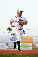 Daytona Tortugas shortstop Blake Trahan (7) jogs to the dugout during a game against the Fort Myers Miracle on April 17, 2016 at Jackie Robinson Ballpark in Daytona, Florida.  Fort Myers defeated Daytona 9-0.  (Mike Janes/Four Seam Images)
