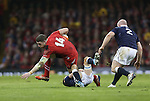 Scotland scrum half Greig Laidlaw tackles Wales wing Alex Cuthbert.<br /> RBS 6 Nations 2014<br /> Wales v Scotland<br /> Millennium Stadium<br /> <br /> 15.03.14<br /> <br /> ©Steve Pope-SPORTINGWALES