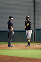 Bristol Pirates shortstop Victor Ngoepe (5) talks with umpire Zachary Robbins during a game against the Bluefield Blue Jays on July 26, 2018 at Bowen Field in Bluefield, Virginia.  Bristol defeated Bluefield 7-6.  (Mike Janes/Four Seam Images)
