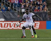 Foxborough, Massachusetts - August 13, 2016: First half action. In a Major League Soccer (MLS) match, New England Revolution (blue/white) vs Philadelphia Union (white), at Gillette Stadium.