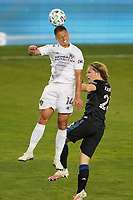 SAN JOSE, CA - OCTOBER 03: Javier Hernandez #14 of the Los Angeles Galaxy goes up for a header with Florian Jungwirth #23 of the San Jose Earthquakes during a game between Los Angeles Galaxy and San Jose Earthquakes at Earthquakes Stadium on October 03, 2020 in San Jose, California.