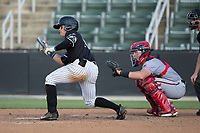 Mitch Roman (10) of the Kannapolis Intimidators squares to bunt against the Hagerstown Suns at Kannapolis Intimidators Stadium on June 15, 2017 in Kannapolis, North Carolina.  The Intimidators walked-off the Suns 5-4 in game one of a double-header.  (Brian Westerholt/Four Seam Images)