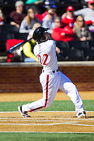 Matt Williams (22) of the Cincinnati Bearcats follows through on his swing against the Radford Highlanders at Wake Forest Baseball Park on February 22, 2014 in Winston-Salem, North Carolina.  The Highlanders defeated the Bearcats 6-5.  (Brian Westerholt/Four Seam Images)