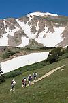 Peak climbers on Herman Gulch Trail in James Peak Wilderness Area, west Georgetown, Colorado, USA.