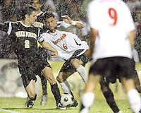 Rich Costanzo #6 of the University of Maryland tries to get around Sam Cronin #2 of Wake Forest University in a driving rain storm during an ACC men's soccer match at Ludwig Field, University of Maryland on September 26 2008 in College Park, Maryland. Wake Forest won 4-2 in front of a record sold out crowd of 6,500.