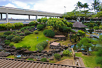Only in Hawaii would one expect to find a beautiful oasis of serenity at an airport!  You can see the tail of a passenger jet in the upper-left corner of this image.<br /> <br /> Canon EOS 5D, 24-105L lens