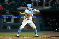Michael Busch (15) of the North Carolina Tar Heels at bat against the Miami Hurricanes in the second semifinal of the 2017 ACC Baseball Championship at Louisville Slugger Field on May 27, 2017 in Louisville, Kentucky. The Tar Heels defeated the Hurricanes 12-4. (Brian Westerholt/Four Seam Images)