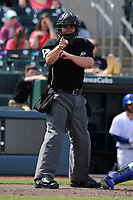 Home plate umpire Ryan Blakney in action during an Iowa Cubs game against the Round Rock Express at Principal Park on April 16, 2017 in Des  Moines, Iowa.  The Cubs won 6-3.  (Dennis Hubbard/Four Seam Images)