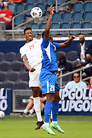 KANSASCITY, KS - JULY 11: Mark-Anthony Kaye #14 of Canada wins the header during a game between Canada and Martinique at Children's Mercy Park on July 11, 2021 in KansasCity, Kansas.