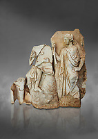 Roman Sebasteion relief  sculpture of Apollo and a Muse Aphrodisias Museum, Aphrodisias, Turkey.  Against a grey background.<br /> <br /> On the left stood Apollo, one foot raised on a rock, playing his lyre which rests on top of the omphalos (the earth's navel stone, tied down at Delphi(. On the right stands a muse holding one arm of Apollos lyre.