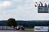 #9: Scott Dixon, Chip Ganassi Racing Honda takes the checkered flag