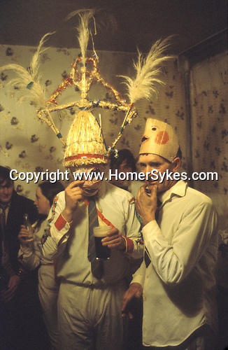 Biddy Boys 1970s. Killorglin,  Co Kerry Ireland. February 2nd festival to celebrate the Celtic Saint Brigid. A doll - St Bridgid - is taken from  house to house by teams of Biddy Boys. They are in dfisguise often and the leaders where the traditional straw conocal hat.