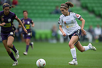 MELBOURNE, AUSTRALIA - DECEMBER 18: Stephanie CATLEY of the Victory runs with the ball during the round 7 W-League match between the Melbourne Victory and the Perth Glory at AAMI Park on December 18, 2010 in Melbourne, Australia. (Photo Sydney Low / asteriskimages.com)