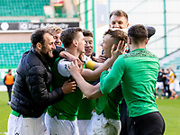 24th April 2021; Easter Road, Edinburgh, Scotland; Scottish Cup fourth round, Hibernian versus Motherwell; Ryan Porteous of Hibernian is is mobbed by his team mates after scoring the winning penalty to take Hibs through to the semi finals of the cup