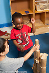 Education Preschool Headstart 3-4 year olds two boys building with wooden blocks together