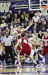 Klay Thompson (arms raised) gets called for his 4th foul as UW's Venoy Overton (#1) drives towards the basket during a critical part of the 2nd half during the Cougars Pac-10 conference showdown with the University of Washington on March 7, 2009, in Seattle, Washington.  Both teams came in to the game on a roll, and in a hard fought battle, the Huskies prevailed 67-60 to wrap up the regular season Pac-10 championship.