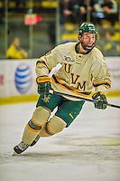 29 December 2013:  University of Vermont Catamount Forward Matt White, a Senior from McMurray, PA, in second period action against the Canisius College Golden Griffins at Gutterson Fieldhouse in Burlington, Vermont. The Catamounts defeated the Golden Griffins 6-2 to capture the 2013 Sheraton/TD Bank Catamount Cup NCAA Hockey Tournament for the second straight year. Mandatory Credit: Ed Wolfstein Photo *** RAW (NEF) Image File Available ***