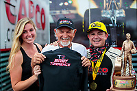 xSep 27, 2020; Gainesville, Florida, USA; NHRA top fuel driver Steve Torrence (right) celebrates the news of a coming baby with Don Garlits (center) and wife Natalie Torrence after winning the Gatornationals at Gainesville Raceway. Mandatory Credit: Mark J. Rebilas-USA TODAY Sports