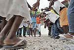 Haitian girls participate in activities at a youth center run by the YWCA in Petionville. The program educates and empowers girls, many of whom don't go to school, who come from families affected by the January 2010 earthquake. Many live in tents that fill a nearby park.