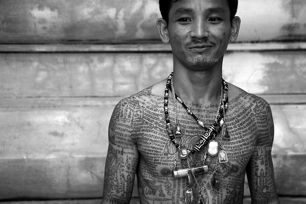 One of Thailand's stranger festivals, the annual tattoo festival at Wat Bang Phra is not for the faint hearted.....Every year, some 6,000 people gather at Bang Phra temple near Bangkok. They come to be blessed and to be tattooed. During a religious ceremony in the morning, many of them are possessed by spirits. They become different animals, depending on what tattoos they have on their bodies.