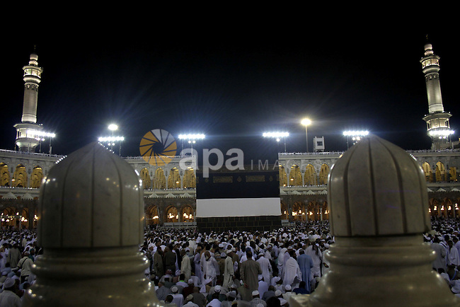 Muslim pilgrims gather inside the Grand Mosque in the holy city of Mecca on November 23, 2009. Some 2.5 million Muslims from more than 160 countries converge annually on the Islamic holy cities of Mecca and Medina in western Saudi Arabia. Photo by Ashraf Amra