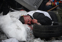 An injured protester fell into the barricades.  Kiev, Ukraine