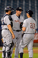 Lakeland Flying Tigers pitching coach Mike Maroth #46 (center) talks with pitcher Alex Burgos #20 and catcher Zach Maggard during a game against the Tampa Yankees at Steinbrenner Field on April 6, 2013 in Tampa, Florida.  Lakeland defeated Tampa 8-3.  (Mike Janes/Four Seam Images)