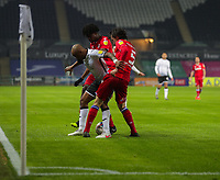 30th December 2020; Liberty Stadium, Swansea, Glamorgan, Wales; English Football League Championship Football, Swansea City versus Reading; Andre Ayew of Swansea City controls the ball while under pressure from Ovie Ejaria and Tom McIntyre of Reading FC