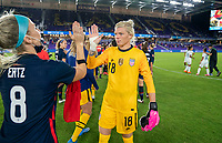 ORLANDO, FL - FEBRUARY 24: Julie Ertz #8 and Jane Campbell #18 of the USWNT shake hands after a game between Argentina and USWNT at Exploria Stadium on February 24, 2021 in Orlando, Florida.