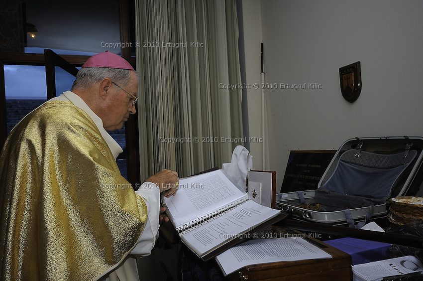 Bishop of Paramaribo Monseigneur Wilhelmus Adrianus Josephus Maria de Bekker checks his notes before the march to ST. Petrus and Paulus Cathedral.....Blessing and First Worship of ST. Petrus and Paulus Cathedral (AKA World's largest wooden cathedral)
