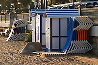 The beach. Deck chairs piled for the night. Changing cabins. Sitges, Catalonia, Spain