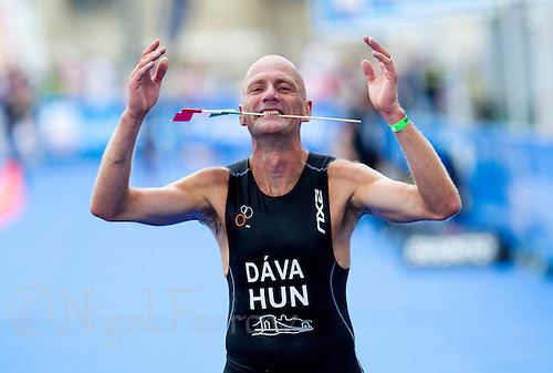 12 SEP 2010 - BUDAPEST, HUN - A competitor celebrates finishing at the 2010 ITU World Age Group Triathlon Championships .(PHOTO (C) NIGEL FARROW)