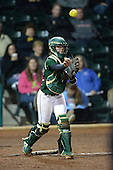 University of South Florida Bulls catcher Lee Ann Spivey (19) throws to first during a game against the Michigan Wolverines on February 8, 2014 at the USF Softball Stadium in Tampa, Florida.  Michigan defeated USF 3-2.  (Copyright Mike Janes Photography)