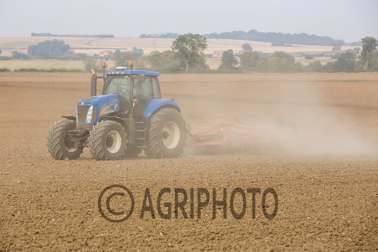 New Holland T8050 working very dry land down with a Simba cultipress <br /> Picture Tim Scrivener 07850 303986