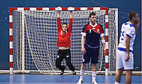 02 NOV 2011 - LONDON, GBR - Britain's Bobby White (left) stretches during a break in play during the Men's 2013 World Handball Championship qualification match against Israel at the National Sports Centre at Crystal Palace (PHOTO (C) NIGEL FARROW)