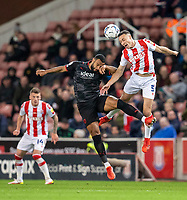 1st October 2021;  Bet365 Stadium, Stoke, Staffordshire, England; EFL Championship football, Stoke City versus West Bromwich Albion; James Chester of Stoke City heads the ball away