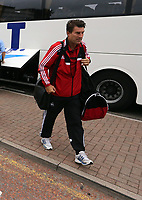Wednesday 28 August 2013<br /> Pictured: Michael Laudrup arriving at Cardiff Airport.<br /> Re: Swansea City FC players and staff en route for their UEFA Europa League, play off round, 2nd leg, against Petrolul Ploiesti in Romania.